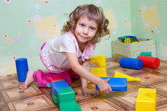 The girl has built a tower out of blocks Stock Images