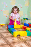 The girl has built a tower out of blocks Royalty Free Stock Image