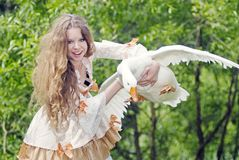 Girl has caught a goose Royalty Free Stock Photos