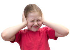 The girl has closed ears hands. Isolated Stock Image