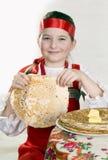 Girl has control over a pancake Royalty Free Stock Photos