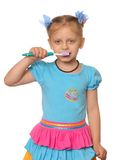 Girl has control over a tooth-brush Royalty Free Stock Photos