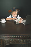 Girl has earned a lot of money. Uses internet by laptop. Banker holds in hand American dollars. Smart  female Stock Photos