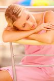 Girl has fallen asleep on chair Stock Images