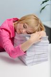 The girl has fallen asleep on documents Stock Image