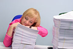 The girl has fallen asleep on documents Stock Photography