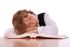 Girl has fallen asleep near the book Stock Photography