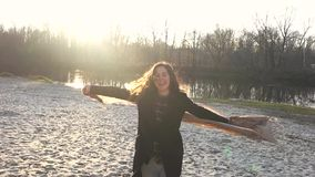 The girl has fun near the pond stock footage
