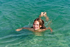 Girl has fun in the ocean Stock Image