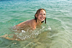 Girl has fun in the ocean Royalty Free Stock Images