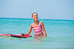 Girl has fun with the surfboard Royalty Free Stock Photography