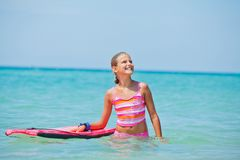 Girl has fun with the surfboard Royalty Free Stock Images