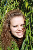 Girl has hidden behind branches. Beautiful young girl has hidden behind branches royalty free stock images