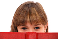 Girl has hidden for the open book Royalty Free Stock Photography