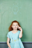 Girl has idea with lightbulb Royalty Free Stock Photo