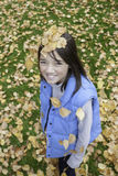 Girl has leaves on her head. Royalty Free Stock Photography