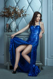 Girl has long evening dress with a cut  legs. Royalty Free Stock Photography