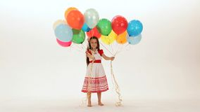 Girl Has A Lot Of Balloons stock video footage