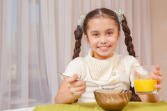 Girl has lunch at home Stock Images