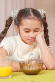 Girl has lunch at home Stock Photo