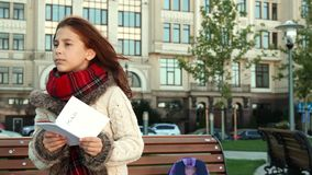 The schoolgirl is trying to navigate by the map royalty free stock photo