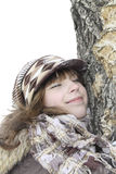 The girl has nestled a cheek on a tree trunk Stock Images