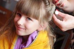 Girl has one's hair waved Stock Photo