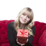 Girl has a present box for you Stock Photography