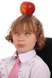Girl has put an apple on a head Royalty Free Stock Photography