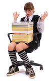 Girl has put the big pile of books on knees Stock Images