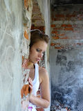 Girl has reflected on building. Very young girl has reflected on building stock image