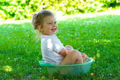 Girl has a refreshment. Little refreshment in the garden stock image