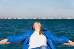 The girl has a rest on the boat Stock Image