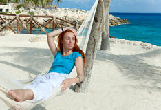 The girl has a rest in a hammock on a beach Royalty Free Stock Photos