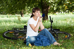 Girl has a rest on a lawn in park Stock Photography