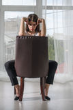 Girl has a rest sitting on a chair Stock Photography