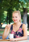 Girl has a rest in street cafe in park Stock Photography