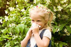 The girl has a runny nose. flowers pollen allergy Royalty Free Stock Photography