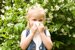 Girl has a runny nose. flowers pollen allergy Stock Image