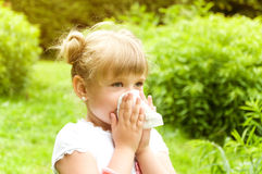 Girl has a runny nose. flowers pollen allergy Royalty Free Stock Images
