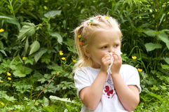 The girl has a runny nose. flowers pollen allergy Royalty Free Stock Image