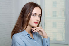 Girl has a sideways attaching her hand to her chin Royalty Free Stock Images
