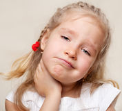 Girl has a sore throat. Child has a sore throat. Angina Stock Photography