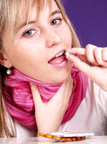 Girl has a sore throat Royalty Free Stock Image