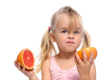 Girl has sour fruit face Royalty Free Stock Images