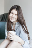 The girl has tea in the morning. Smiling girl has tea in the morning. Tea - Hot Drink, Women, Drinking, Coffee - Drink, Cup Royalty Free Stock Images