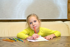 Girl has thought of drawing. Royalty Free Stock Photos