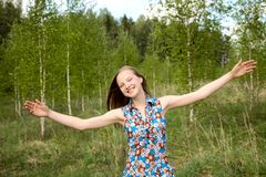 Girl has widely stretched hands Royalty Free Stock Image