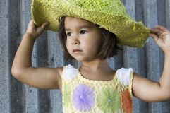 Girl in a hat 03. Little girl wearing green hat Stock Photography