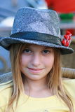 Girl with hat. Blond girl with a cool hat royalty free stock photography
